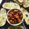 Roasted Tomatoes in Garlic Olive Oil with Pesto Crostini