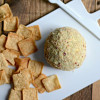 Spinach and Artichoke Cheese Ball Covered in Bacon Breadcrumbs