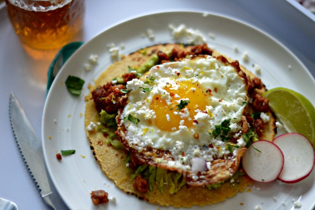 topped with smashed avocado, spicy chorizo, and a crispy fried egg ...