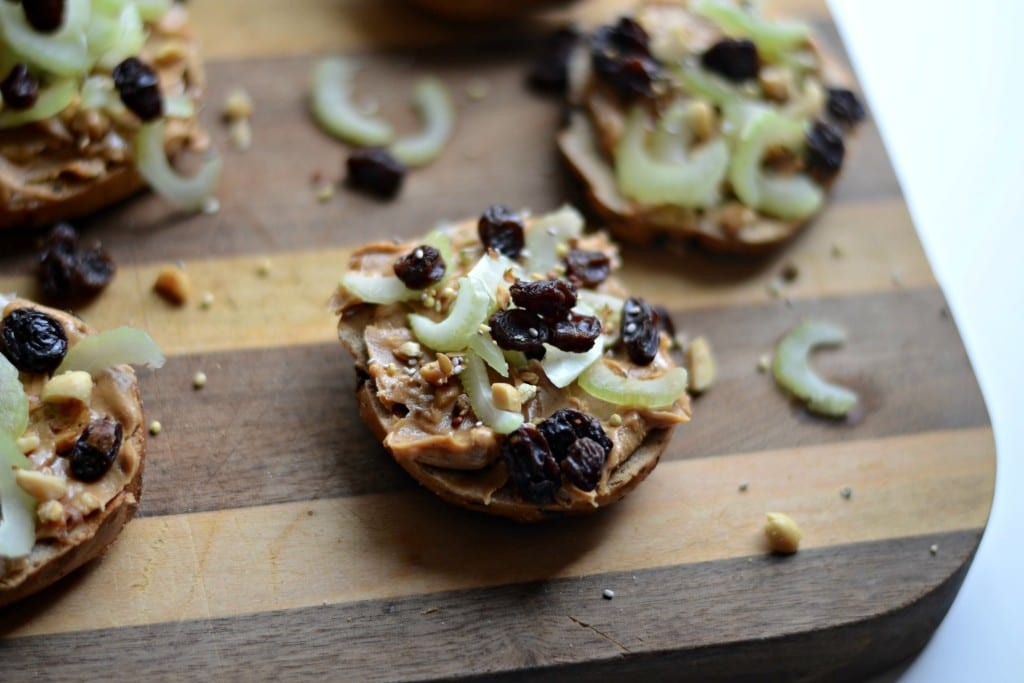 Ants on a Log Snack Bagel (with chopped peanyus, hemp, chia, and flax seeds) | Sarcastic Cooking